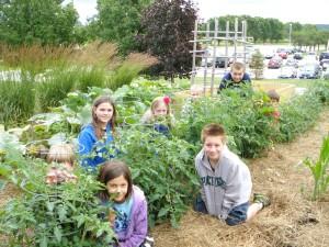 kids working in the junior master garden