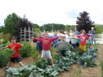 kids pretending to be scarecrows