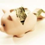 white piggy bank with dollar bills in it