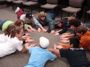 Youth playing a game called hand zap