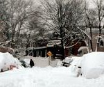 piles of snow next to building