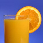 glass of orange juice with an orange slice