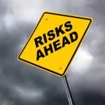 risks ahead road sign