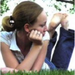 a teenager relaxing on the grass