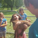 Participants at Cloverbud Day Camp enjoyed playing with the goats from Cristo Rey Ranch.