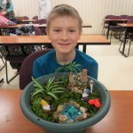 Family Learning Day boy with his mini garden project