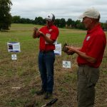 2 speakers in red shirts and the healthy soil- healthy water presentation