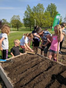 Kids from Fond du Lac County Junior Master Gardener program working in a raised garden
