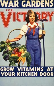 Woman holding a basket of fresh vegetables