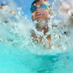 boy being splashed in waterpark