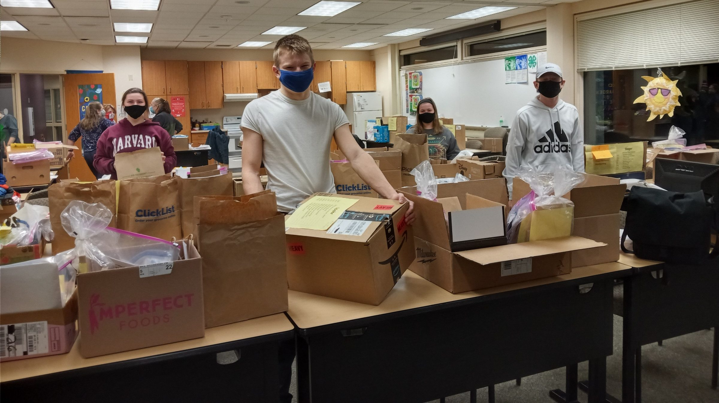 Teen Leaders preparing project kits for Family Learning Day